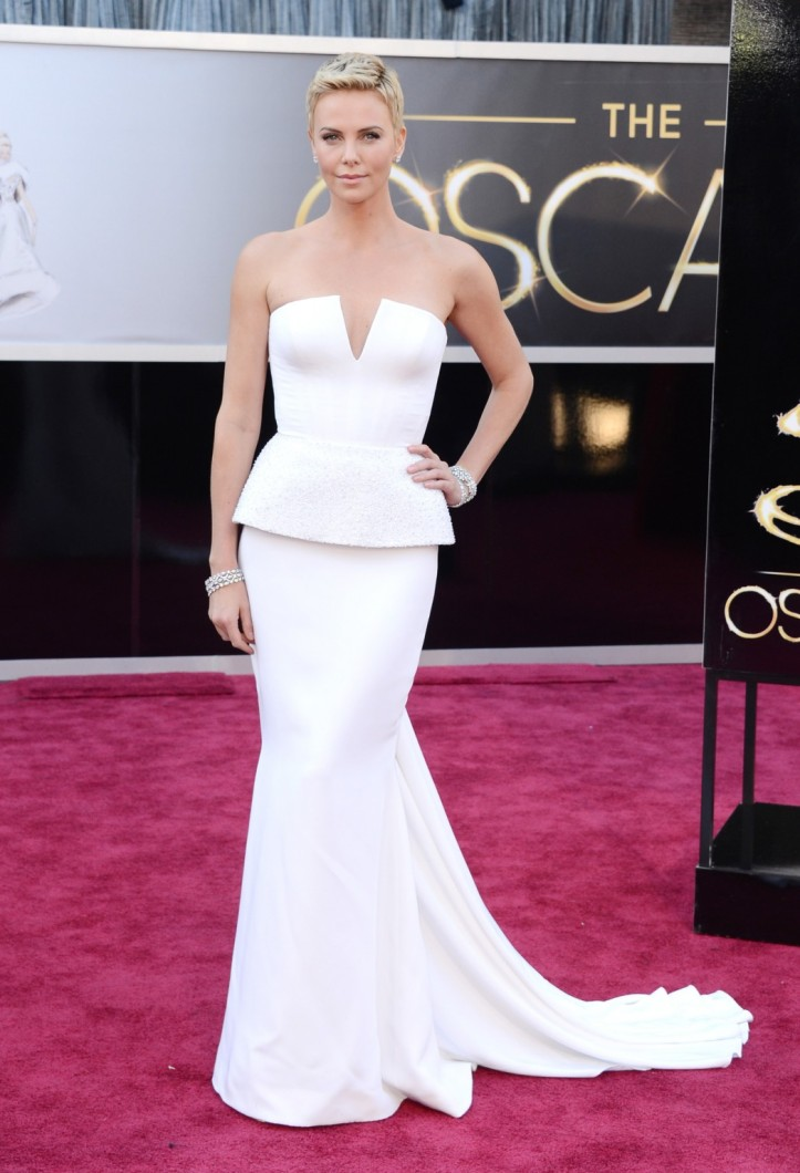 Charlize Theron in Dior Haute Couture gown.  Jewelry by Harry Winston.