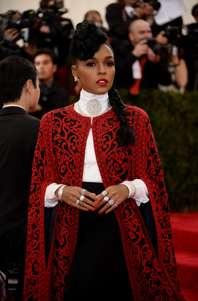 Janelle Monae in a red cape. (Photo by Dimitrios Kambouris/Getty Images)