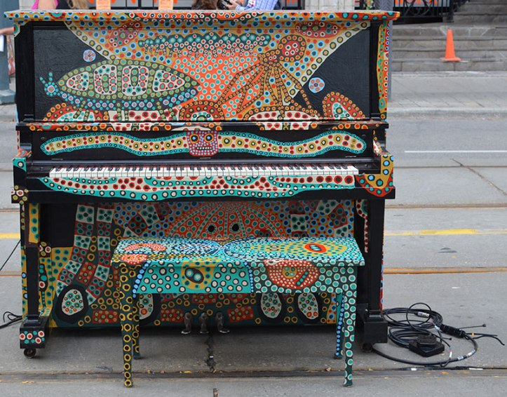 Piano that was on King Street West decorated with paint by artist  (Photo courtesy Now Toronto)