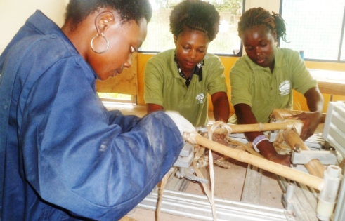Women building bamboo bikes in Ghana.