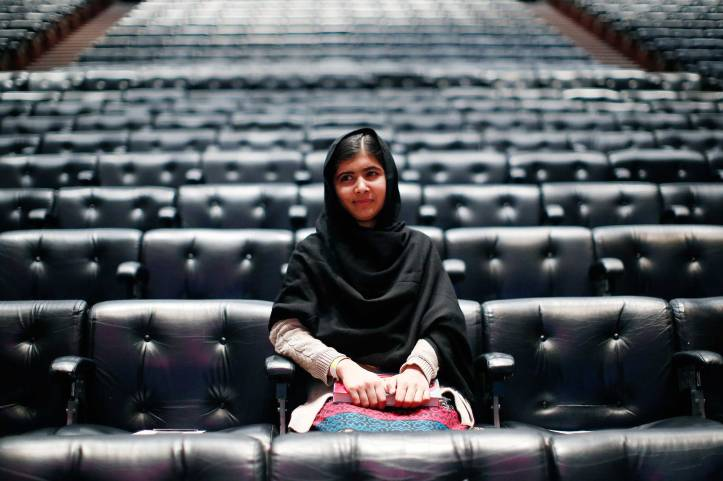 "Pakistani teenage activist Yousafzai poses for pictures before an event launching her memoir ""I Am Malala"" in London"
