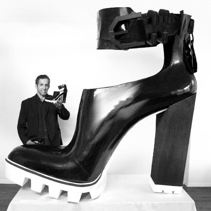 Fashion Designer Kenneth Cole with his Guinness World Record Largest High-Heeled Shoe (PRNewsFoto/Kenneth Cole Productions, Inc.)