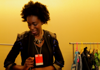 Backstage I tried on this jacket by Korlekie while reporting from behind the scenes.
