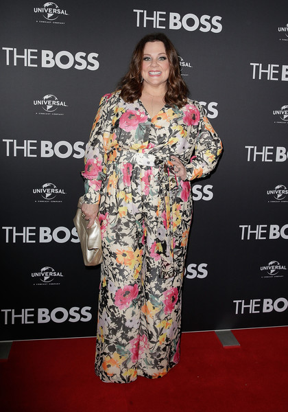 Melissa McCarthy in floral jumpsuit on the red carpet.