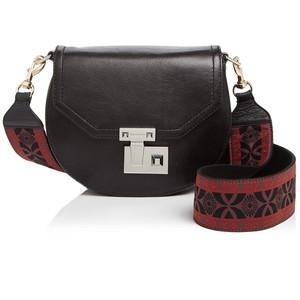 Rebecca Minkoff Embroidered Guitar strap handbag.